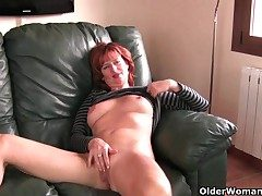 Redheaded grown-up mama plays with her nipples together with pussy
