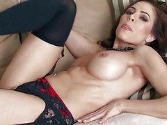 Erika Jordan is a obese boobed seductress down black nylons.