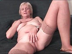 Granny strips upon stockings and fingers pussy
