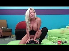Buxom Britney Amber rides Sybian saddle and moans