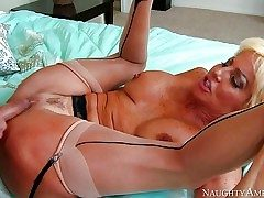 Mature slut Tara Holiday with big fake bra-stuffers is his